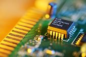 Electronic chip on circuit board. Macro close-up, shallow DOF. poster