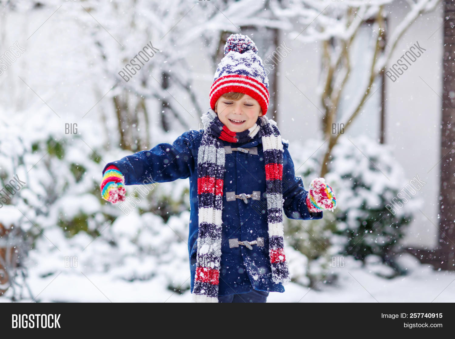 Cute Little Funny Child In Colorful Winter Fashion Clothes Having Fun And  Playing With Snow 965968d04