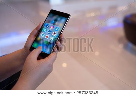 Chiang Mai, Thailand - August 03,2018: Woman Holding Huawei With Icons Of Social Media On The Screen