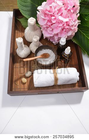 Spa background with pink hydrangea with towel , with herbal in basket
