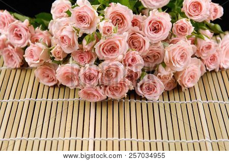 Set of bouquet rose on bamboo mat background
