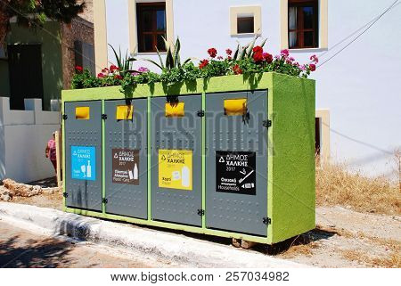 HALKI, GREECE - JUNE 16, 2017: Household waste recycling bins at Emborio on the Greek island of Halki. The scheme was started in 2013.