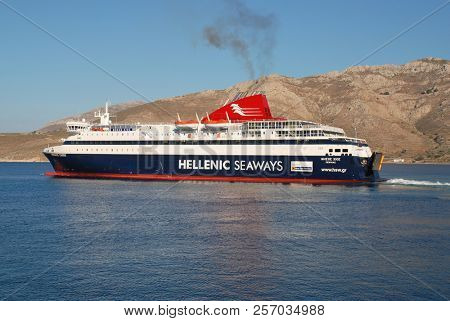 TILOS, GREECE - JUNE 18, 2018: Hellenic Seaways ferry boat Nissos Chios departs Livadia harbour on the Greek island of Tilos. The 141mtr vessel was built in 2007 in Greece.