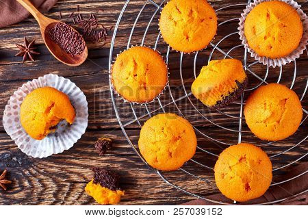 Freshly Baked Delicious Sweet Pumpkin Muffins On A Rustic Wooden Table, Delicious Autumn Dessert For