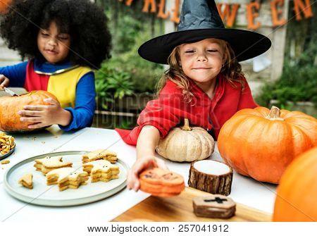 Kids in costume enjoying Halloween season
