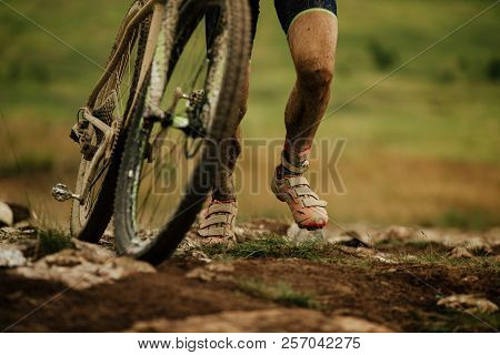 Dirty Feet Cyclist Uphill Walk With Mountain Bike