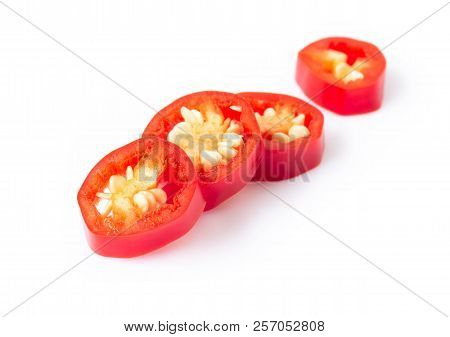 Red Chili Pepper Sliced On White Background, Raw Food Ingredient Concept