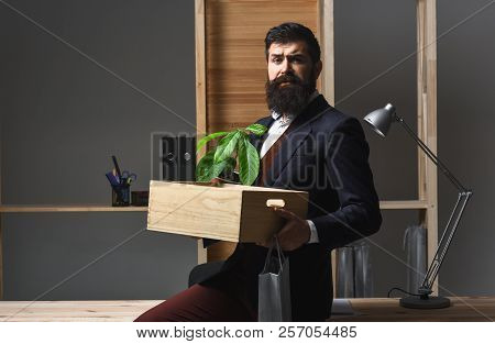 Concept Promotion At Work. Business Man With Box For Moving In New Office. Career Job Search Concept