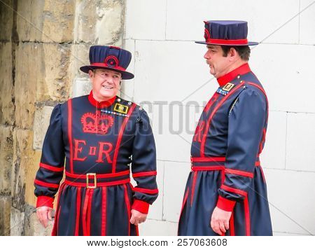 London, United Kingdom - June 09, 2013: Beefeaters Near Walls Of The Tower Of London. Beefeaters Or