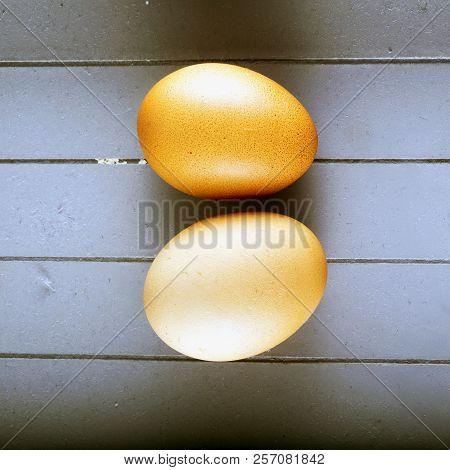 Eggs Over Grey Wood