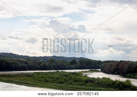 River Under Scenographic Cloudy Sky