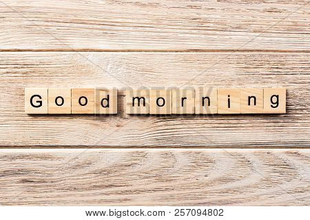 Good Morning Word Written On Wood Block. Good Morning Text On Table, Concept.