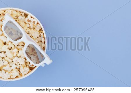 Cinema Concept. Flat Lay. Copyspace. Cinema Concept. Background. 3d Glasses And Cup With Popcorn Iso