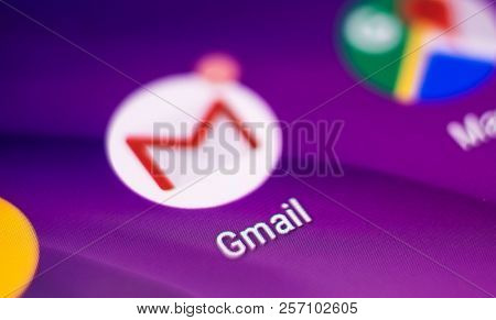 Kharkiv, Ukraine - 14 August, 2018: Closeup mobile Gmail and android google services icons on purple blurred background