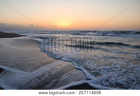 Sunset On The Sea. Golden Hour On The Beach.