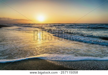Sunset On A Beach. Reflection In The Water Coast.