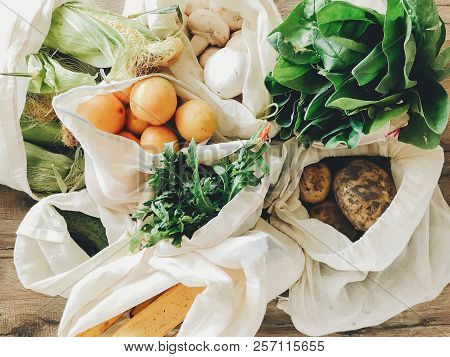 Fresh Vegetables In Eco Cotton Bags On Table In The Kitchen. Lettuce, Corn, Potatoes, Apricots, Bana