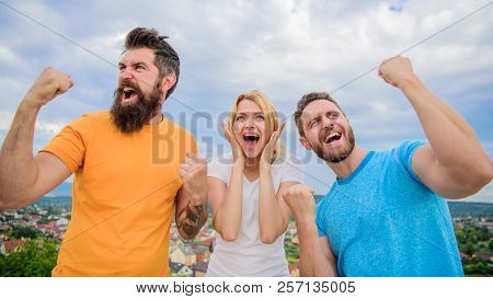 Favorite Team Won Competition. Woman And Men Look Successful Celebrate Victory Sky Background. Three