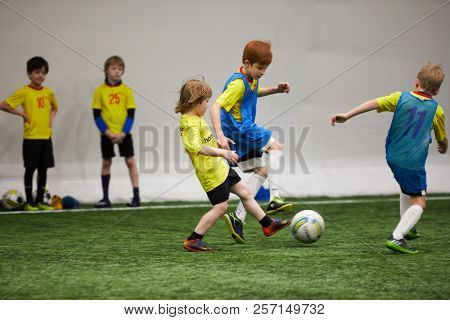 MOSCOW, RUSSIA - JAN 27, 2018: Players of children teams during children sport clubs cup soccer game at indoor sports ground of Krasnaya Presnya stadium.