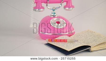 Princess Telephone Next to Open Diary