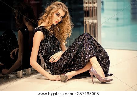 Sexy Girl In Evening Dress Sit On Floor, Fashion. Woman With Makeup, Long Hair, Beauty. Fashion, Vog