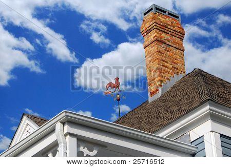 Historic Old Roof with Latticework, Weathervane and Brick Chimney