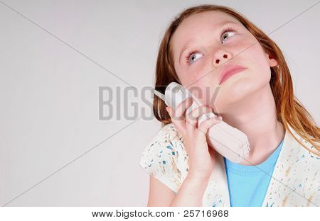 Girl on the phone looking bored or annoyed