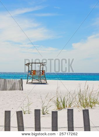 Deserted lifeguard shack on beautiful beach with sand dune fences