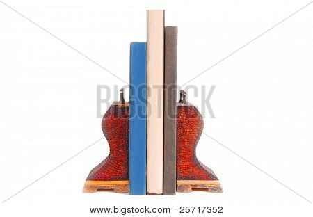 Old books in between worn leather covered bookends