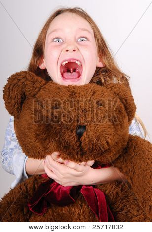 Girl Excitedly Hugging her Bear