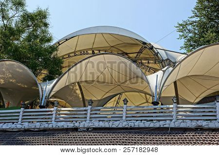 The Semicircular Brown Roof Of The Fabric Of The Tents Behind The Fence