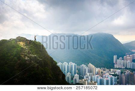 Man Enjoying Fogy Hong Kong View Standing At The Lion Rock Top