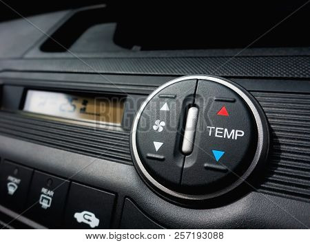 Pressing On Fan Switch Of A Car Air Conditioning System