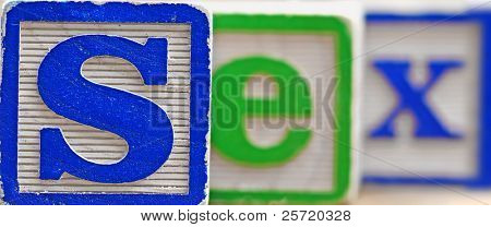 The word sex written in wooden blocks with shallow depth of field