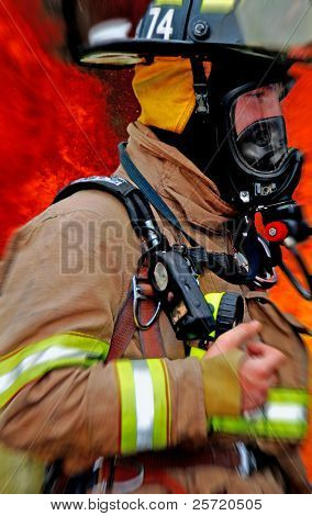 Fireman rushing to scene of large fire