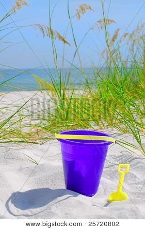 Pretty sand dune with beach bucket