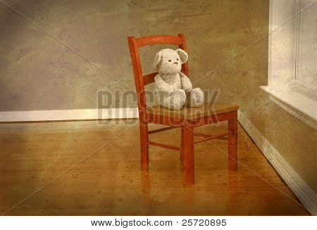 Old fashioned bear on chair alone in room