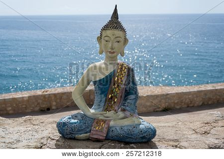 Sculpture That Represents Meditation In The Sea