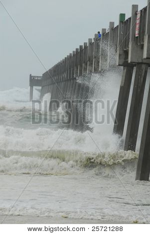 PENSACOLA BEACH - SEPTEMBER 11:  Rough surf & waves caused by Hurricane Ike hit the Pensacola Beach Pier September 11, 2008 in Pensacola, FL. Ike is currently at Category Two.
