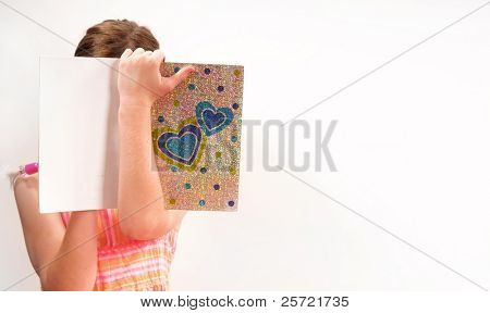 Young girl writing in secret journal