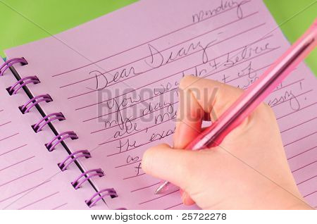 young girl writing in diary