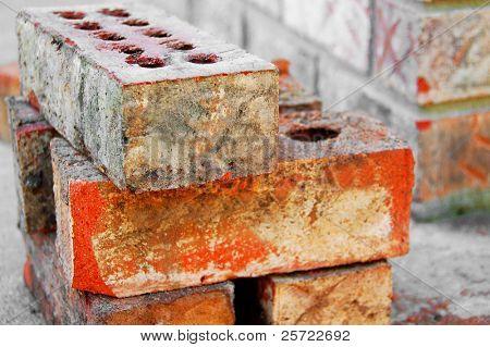 Bricks stacked up for brick mason at construction site