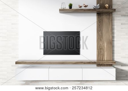 Modern Flat Screen Tv Set Attached To A White Wooden Wall Of A Living Room. A White Set Of Drawers U