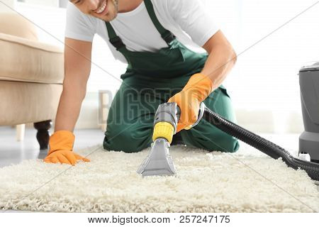 Janitor Removing Dirt From Rug With Carpet Cleaner Indoors, Closeup