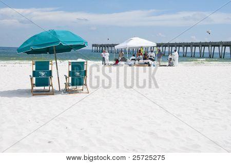 PENSACOLA BEACH - JUNE 23: Beach chairs lie empty on June 23, 2010 in Pensacola Beach, FL.