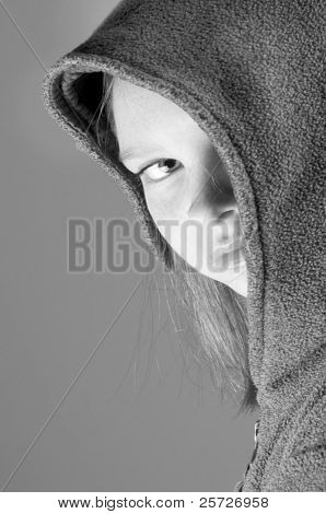 girl hiding behind jacket hood