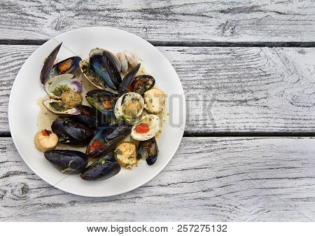 Plate With Seafood Bruschetta (mussels, Clams And Scallops) At Weathered Wood Background. Flat Lay.