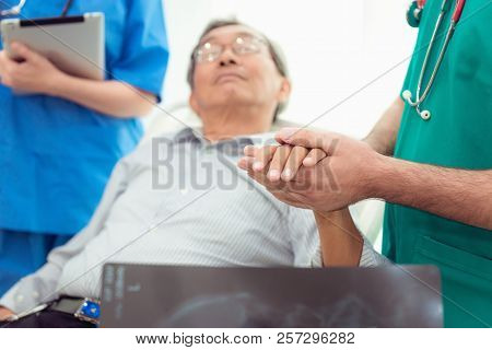 Doctor Reassuring His Male Patient And Consulting Health Problem In Examination Room., Healthcare An
