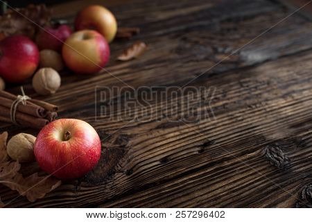 Autumn Red Apples With Cinnamon Sticks