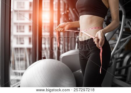 Sporty Woman Using Waist Tape Line In Fitness Gym Sport Club Training Center Near Window With Condom